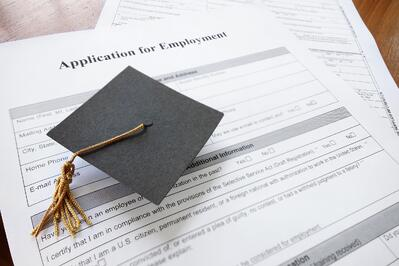 Graduation Cap Sits on an Application for Employment - Are Learners Fully Equipped for Employment?