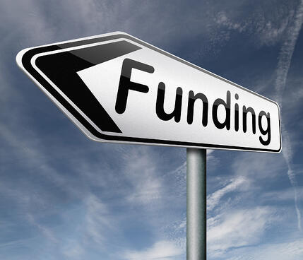 Funding Sign with Blue Sky Background
